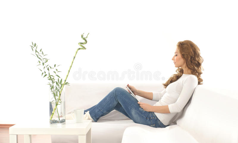 A young Caucasian woman in a modern interior royalty free stock photography