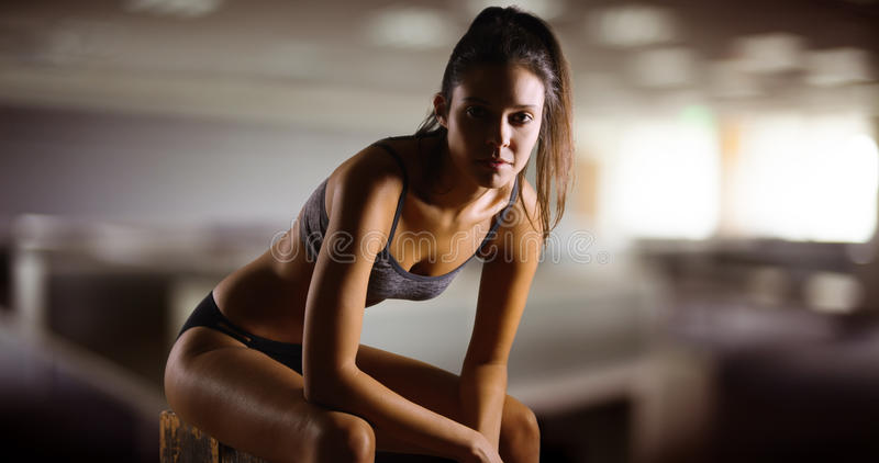 Young Caucasian woman poses for a portrait at the gym stock photo