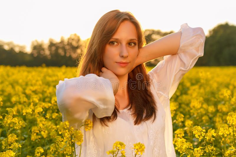 Young caucasian woman is posing in the field of stock photography