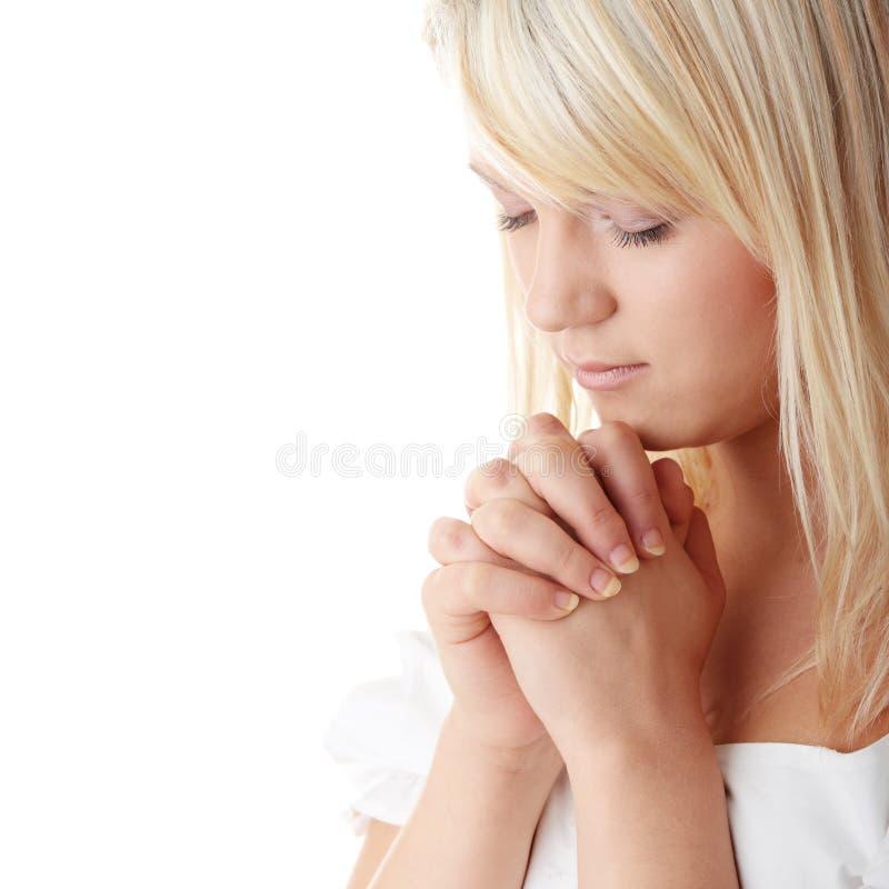 Young caucasian woman praying stock image