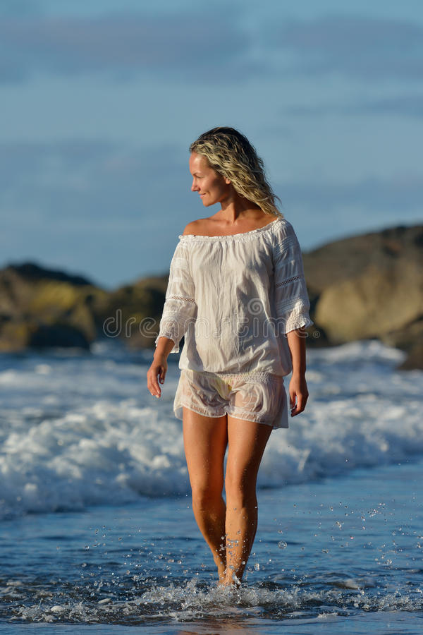 Young caucasian woman refreshing on the beach stock images