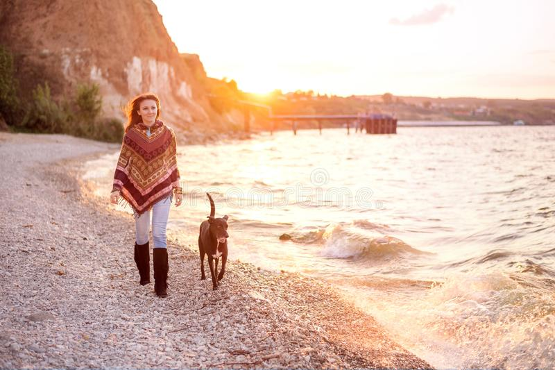 Young caucasian woman walking with her dog stock photos