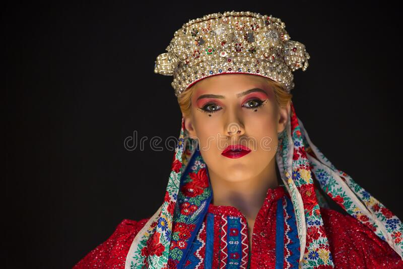 Young caucasian women with pearl corolla and ethno clothes royalty free stock images