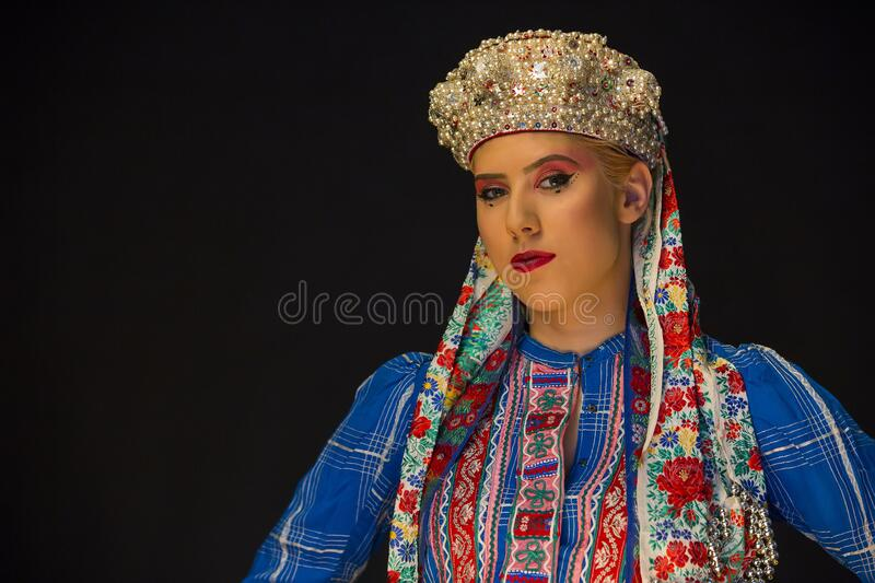 Young caucasian women with pearl corolla and ethno clothes royalty free stock image