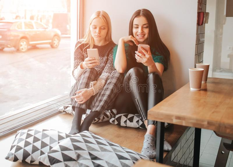 Young caucasian women using phone and saying no to life. Smartphone addiction concept royalty free stock image