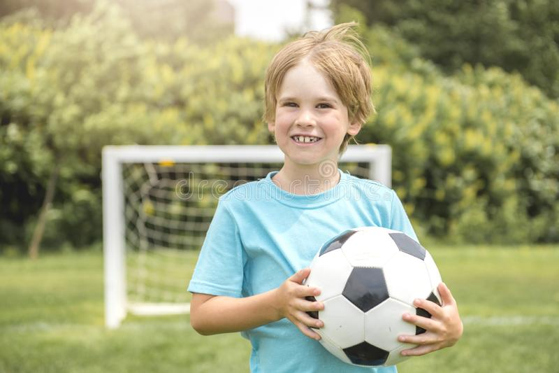 Young caucassian soccer player football outside royalty free stock photo