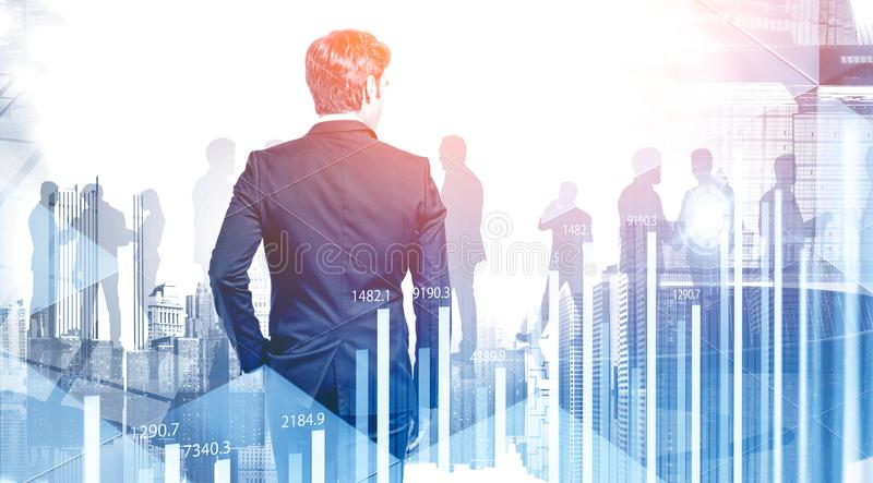 Young CEO in city and his team stock photo