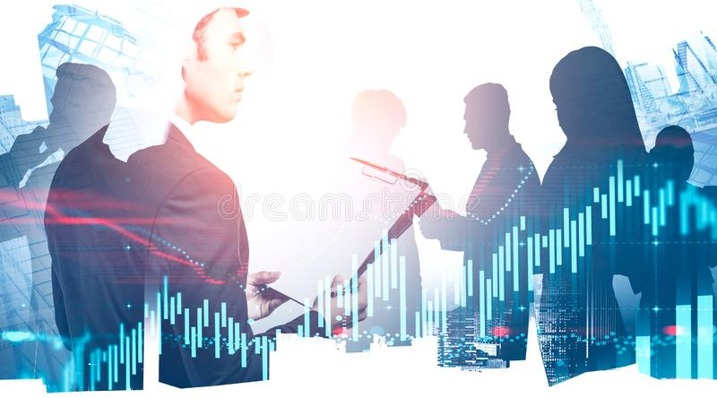 Young CEO and his team in city, graphs stock photos