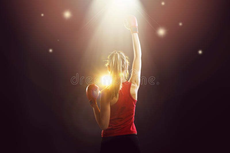 Young champion woman boxer celebrating stock photos