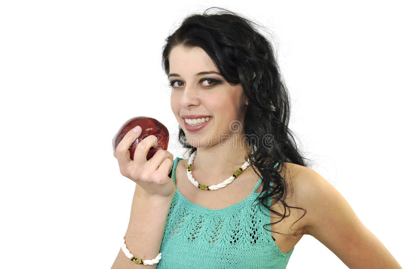 Young charming brunette with an apple stock images