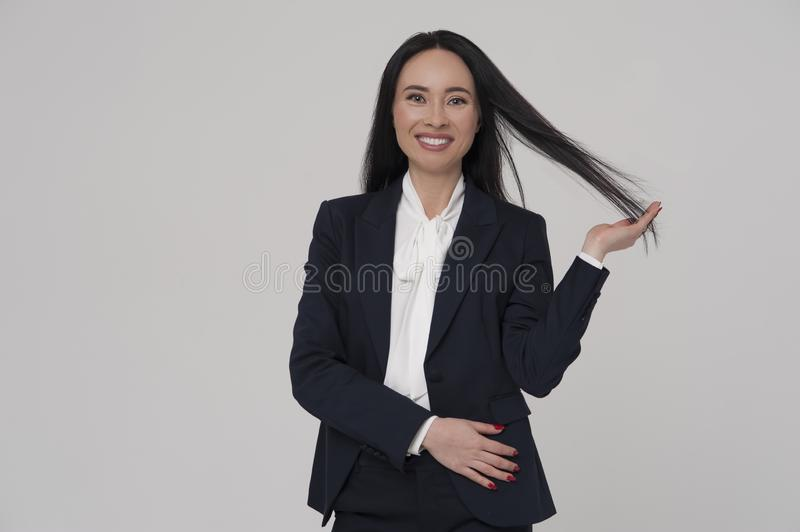 Young charming brunette woman businessperson wearing jacket and blouse stock photo