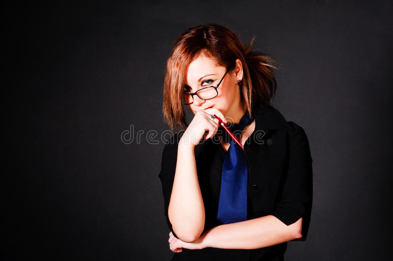 Young Charming Girl In Black Blouse Royalty Free Stock Photography
