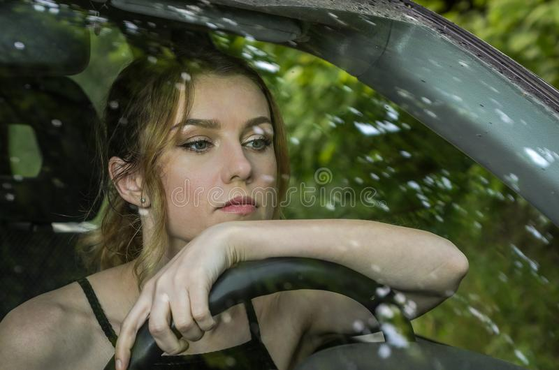Young charming girl driving a car stock photos