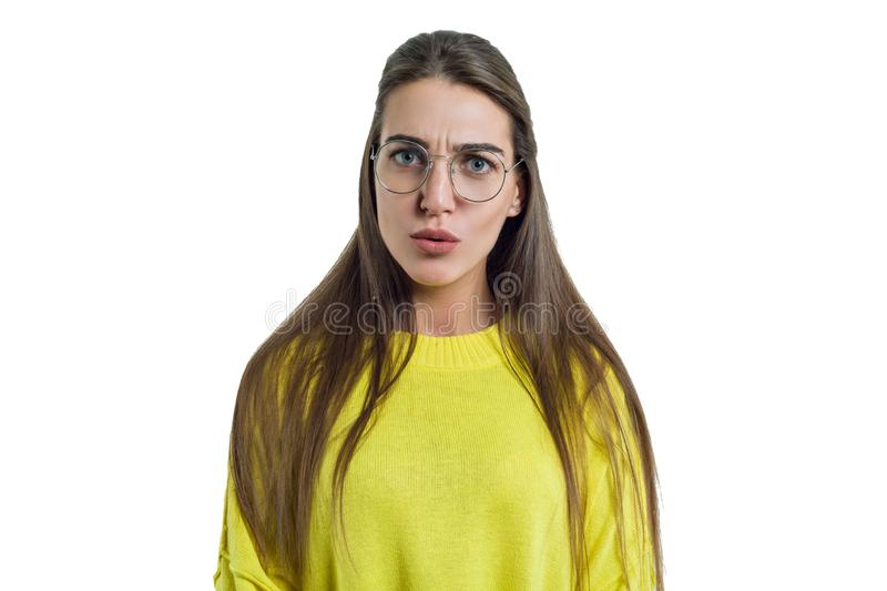Young charming woman in glasses yellow clothes on white isolated background royalty free stock photography