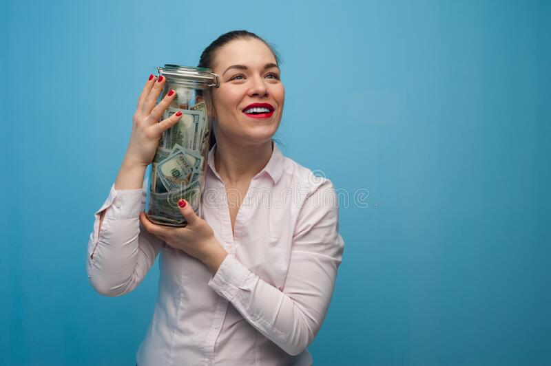 Young charming woman holds a jar royalty free stock images