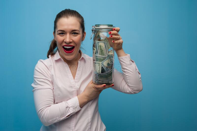 Young charming woman holds a jar stock image