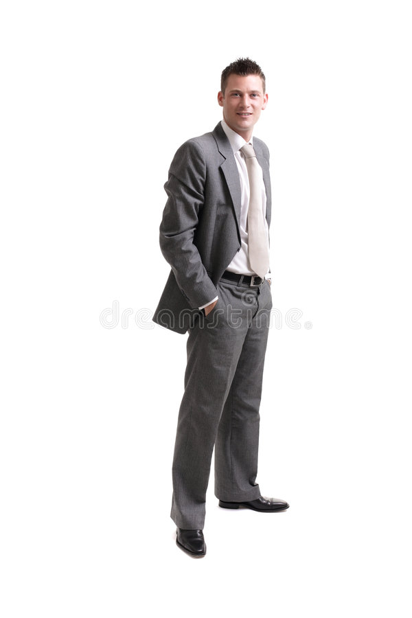 Young cheerful business man. Young satisfied smiling businessman standing over white royalty free stock photos