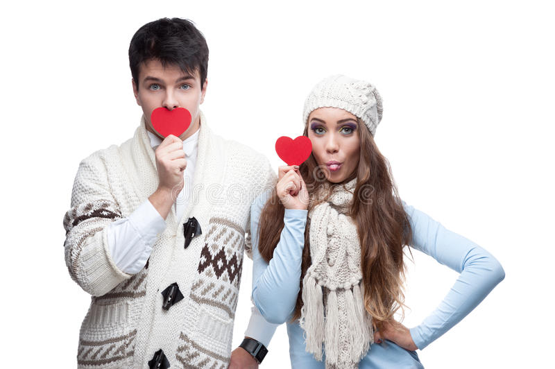 Download Young Cheerful Casual Couple Holding Red Hearts Stock Image - Image: 27774695