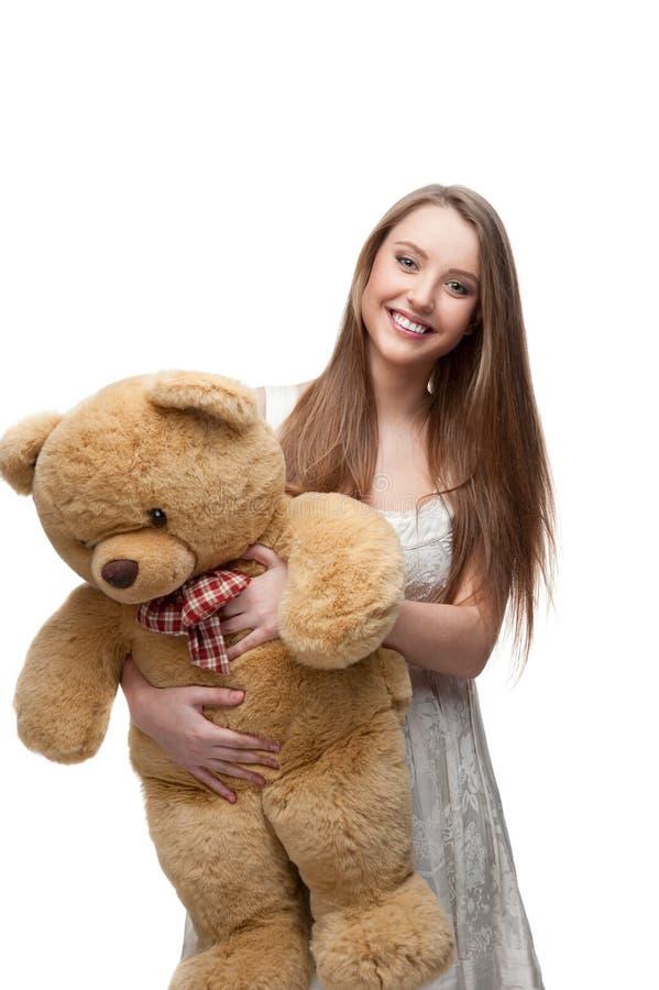 Girl holding soft toy bear stock photos