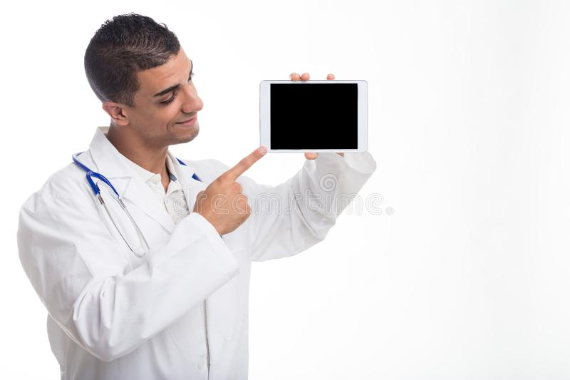 Young cheerful doctor pointing at digital tablet stock images