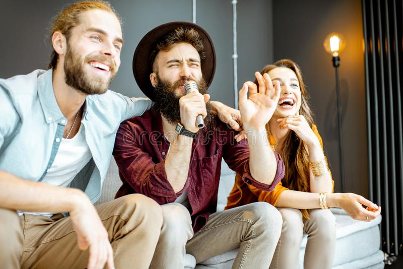 Friends singing at home stock photography