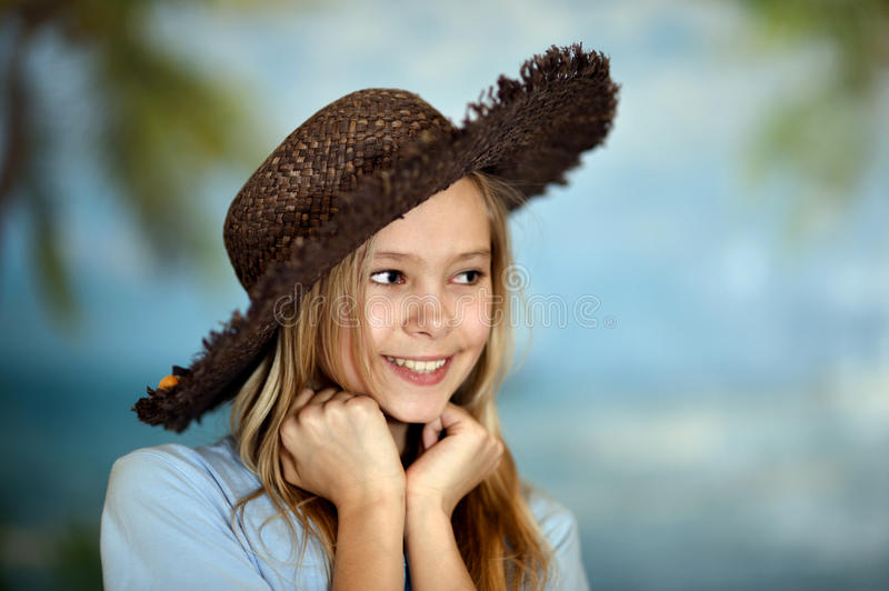Young cheerful girl in a hat stock photography
