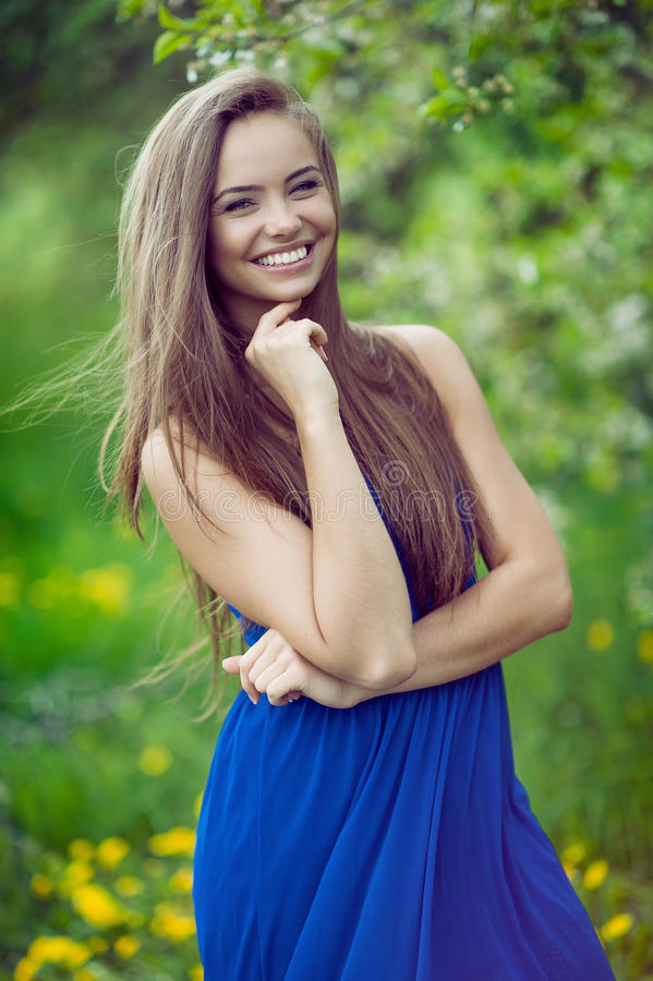 Young cheerful and happy girl posing in spring park.  stock image