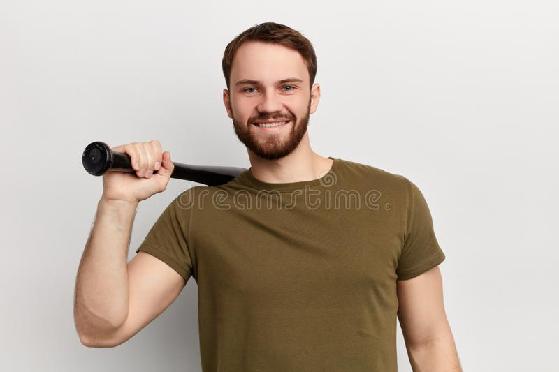 Young cheerful happy man wearing a green T shirt royalty free stock photo