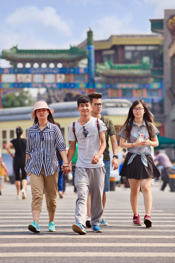 Young cheerful lovers hand in hand, Beijing, China stock photo