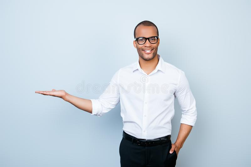 Young cheerful successful african lawyer on the pure light blue royalty free stock image