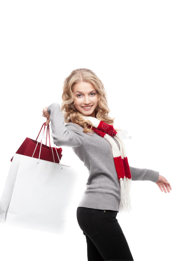 Download Young Cheerful Woman Holding Shopping Bags Stock Image - Image of looking, lady: 27392787