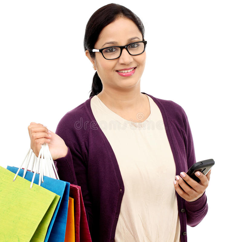 Young cheerful woman holding shopping bags royalty free stock photos