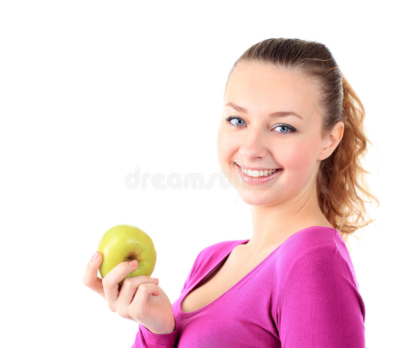 Young cheerful woman in sports wear with apple, isolated over white background stock photo