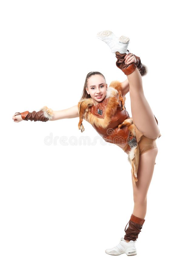 Young cheerleader dressed in a warrior costume stands in vertical splits stock photography