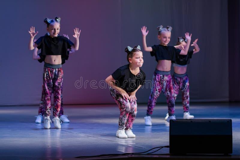 Young cheerleaders perform at the city cheerleading championship. Kamenskoye, Ukraine - October 14, 2018: Championship of the city of Kamenskoye in cheerleading royalty free stock image