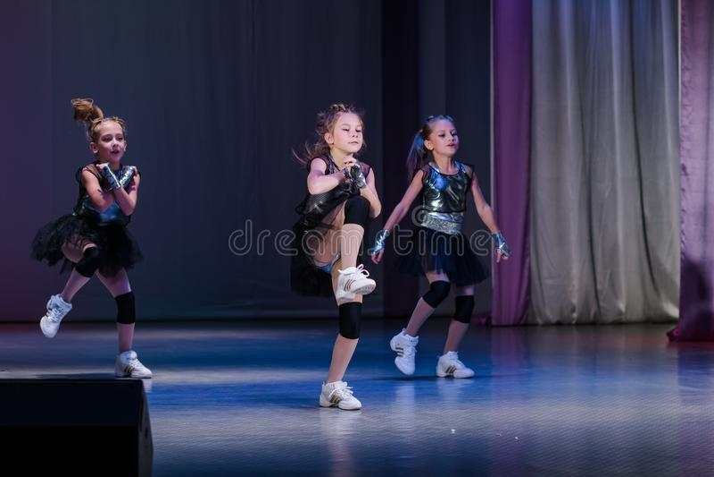 Young cheerleaders perform at the city cheerleading championship. Kamenskoye, Ukraine - October 14, 2018: Championship of the city of Kamenskoye in cheerleading royalty free stock images