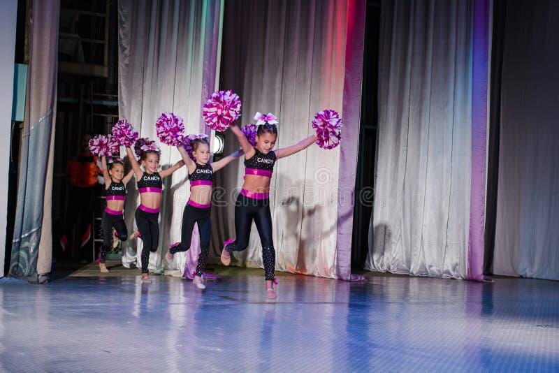 Young cheerleaders perform at the city cheerleading championship. Kamenskoye, Ukraine - October 14, 2018: Championship of the city of Kamenskoye in cheerleading royalty free stock photography