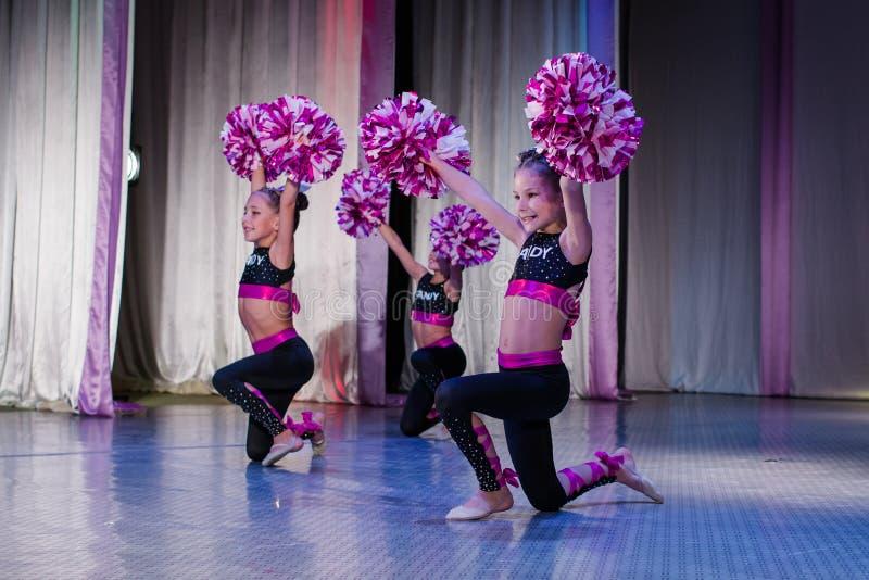 Young cheerleaders perform at the city cheerleading championship. Kamenskoye, Ukraine - October 14, 2018: Championship of the city of Kamenskoye in cheerleading royalty free stock photos