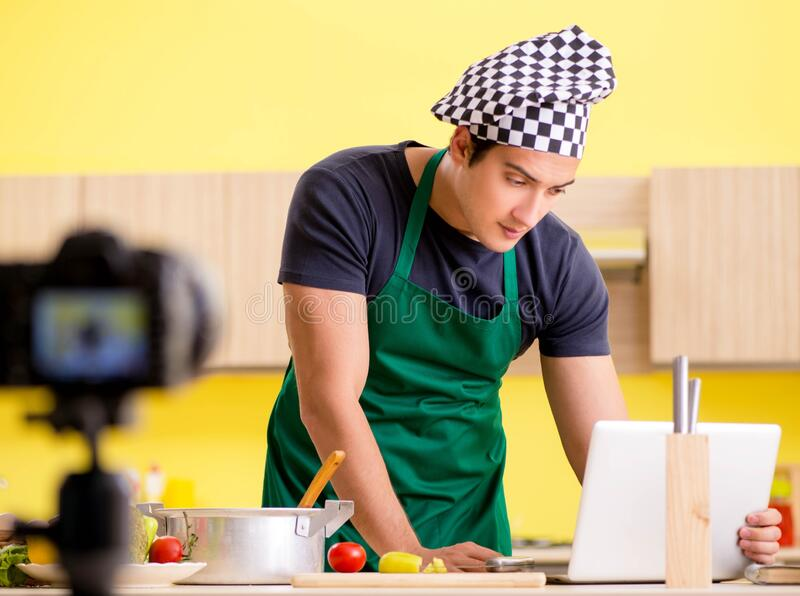 Young chef blogger explaining food preparation. The young chef blogger explaining food preparation stock photo