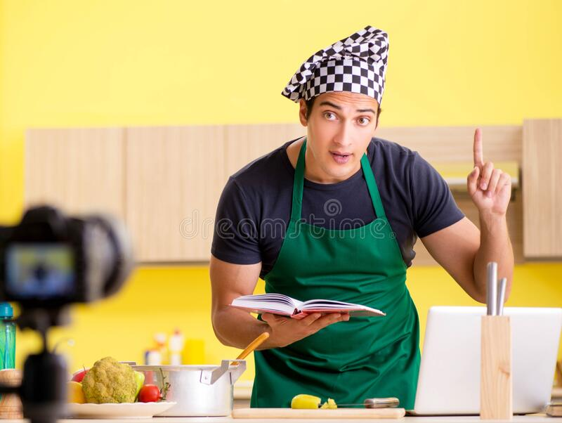 Young chef blogger explaining food preparation. The young chef blogger explaining food preparation royalty free stock photo