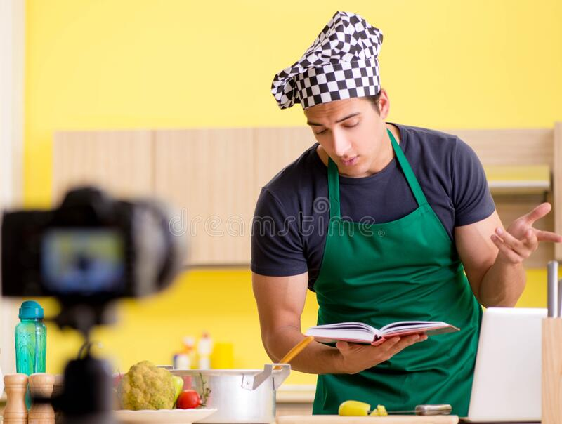 Young chef blogger explaining food preparation. The young chef blogger explaining food preparation royalty free stock image