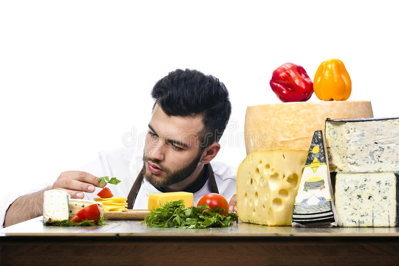 Young chef with cheeses royalty free stock photos