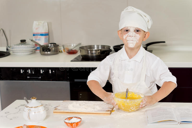 Young chef with flour on his face stock image