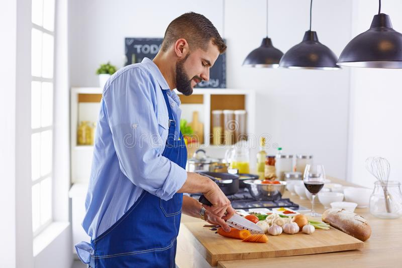 Young chef prepares a man in the kitchen stock photography