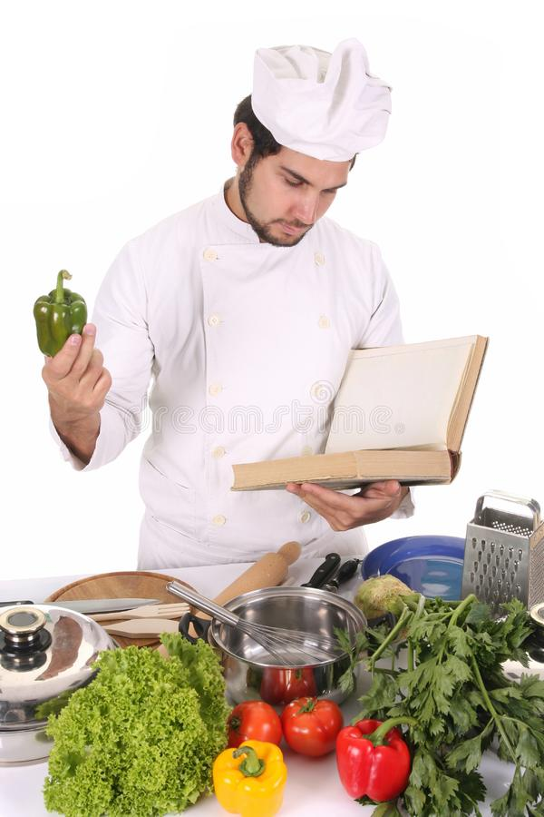 Young chef preparing lunch royalty free stock photo