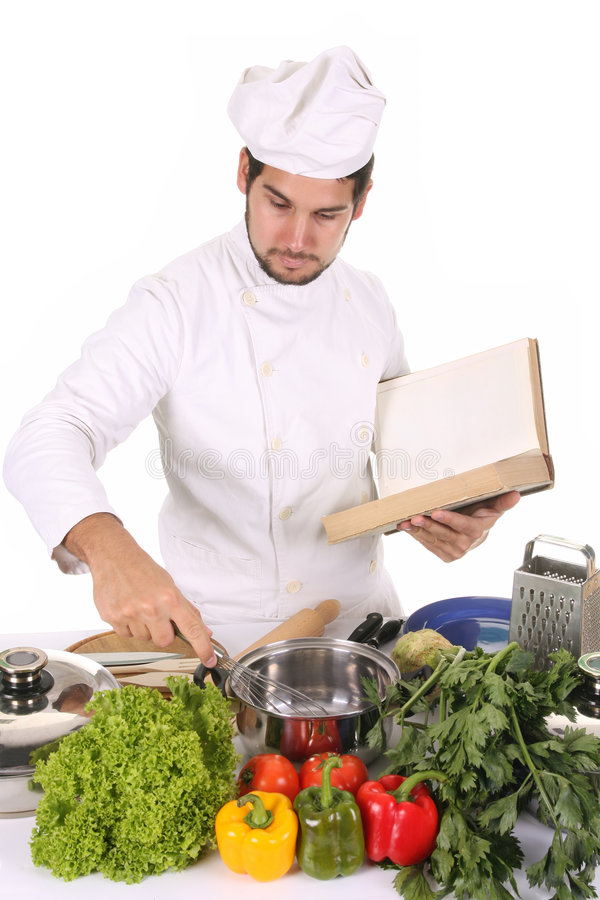 Young chef preparing lunch royalty free stock images
