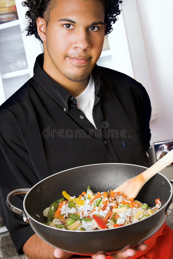 Young chef with wok royalty free stock images