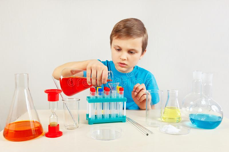 Young chemist doing chemical experiments in laboratory. Young chemist doing chemical experiments in the laboratory royalty free stock photo