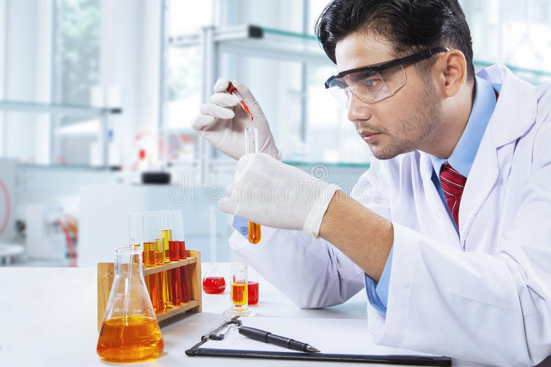 Young Chemist Makes Chemical Test In Lab Stock Image - Image of ...