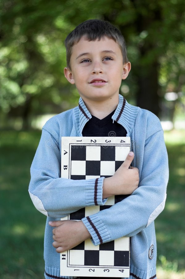 Young chess-player royalty free stock photo